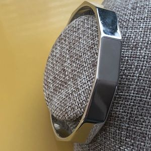 Vintage signed Monet faceted silver tone bangle